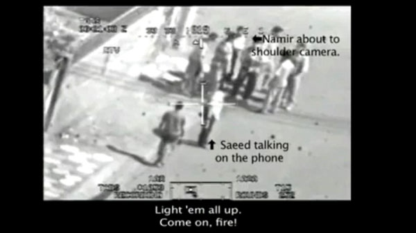 This frame grab image taken from a video shot from a U.S. army Apache helicopter gun-sight, posted at Wikileaks.org and confirmed as authentic by a senior U.S. military official, shows a group of men in the streets of the New Baghdad district of eastern Baghdad just prior to being fired upon by the helicopter July 12, 2007. (AP / Wikileaks.org)