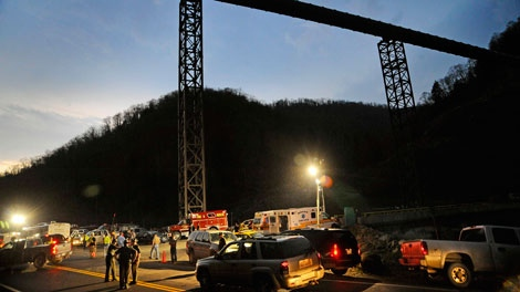 West Virginia State Police direct traffic at the entrance to Massey Energy's Upper Big Branch Coal Mine in Montcoal, W.Va., on Monday, April 5, 2010. (AP / Jeff Gentner)