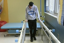 Marc-Andre Emond, 16, practices walking at a physiotherapy session. He suffered a devastating injury when he was hit from behind during a hockey game.