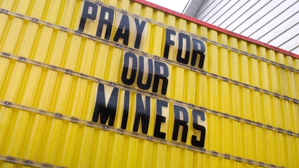 A local church sign shows community support for the coal miners involved in a Monday explosion at Massey Energy Co.'s sprawling Upper Big Branch mine in Montcoal, W.Va. Tuesday, April 6, 2010. (AP / Bob Bird)