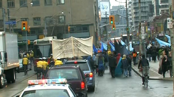 Members of the Grassy Narrows First Nation make their way to Queen's Park to protest, Wednesday, April 7, 2010.