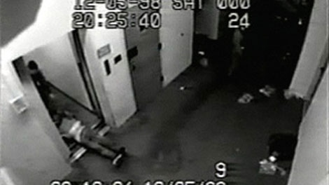 This screengrab taken from a security camera at the jail shows officers dragging Frank Paul crawling by the arms from the drunk tank.