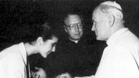 This 1984 photo shows Monsignor Bernard Prince, center, during a meeting between Canadian singer Celine Dion, left, and Pope John Paul II. A Feb. 1993 letter written by late Canadian Bishop Joseph Windle shows church officials in Canada knew of sexual abuse allegations involving Prince before his promotion to a top Vatican post and then discussed with Vatican officials how to keep the scandal from becoming public. (AP Photo/Arturo Mari)