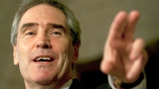 Leader of the Opposition Leader Michael Ignatieff gestures while answering questions from the media on Parliament Hill in Ottawa on Friday, April 9, 2010. (Pawel Dwulit / THE CANADIAN PRESS)