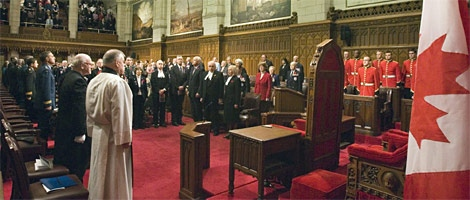 Veterans, members of the Senate and House of Commons, along with other participants, stand for a moment of silence in the Senate chambers on Friday November 2, 2007. (CP / Fred Chartrand)