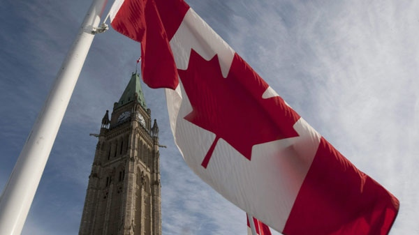 A Canadian flag flies under the Peace Tower Wednesday March 3, 2010. (THE CANADIAN PRESS/Adrian Wyld)