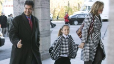 Former Conservative MP Rahim Jaffer arrives with his wife Conservative MP Helena Guergis and Helena's niece Hanna Brayford in this Oct. 30, 2008 photo in Ottawa. (Ryan Remiorz / THE CANADIAN PRESS)