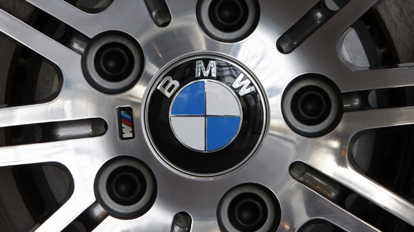 A BMW logo is photographed on a wheel of a BMW prior a press conference in Munich, southern Germany. (AP / atthias Schrader)