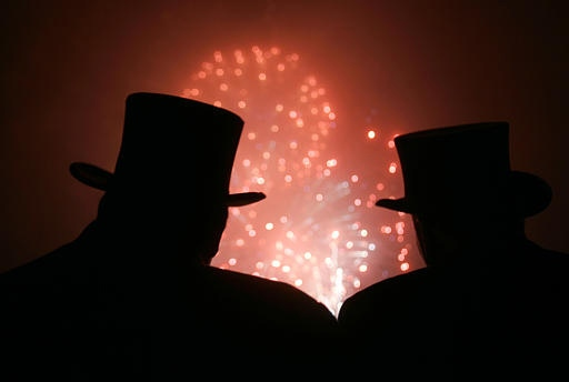 Members of the inner circle of the Punxsutawney Groundhog Club are silhouetted as they watch a fireworks display in Punxsutawney, Pa. on Friday. (AP / Carolyn Kaster)