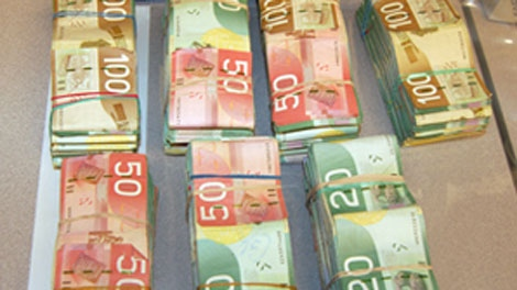 Piles of cash seized by police in Clearwater, B.C., on April 12, 2010. (RCMP)