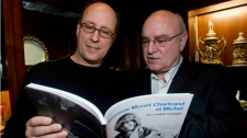 Dominique, left, and Alain Chartrand browse through the pages of 'Simonne Monet Chartrand et Michel', a book about the life of their father Michel Chartrand, at the launch of the book in Montreal Tuesday, March, 2, 2010.