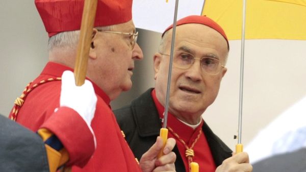 Vatican Secretary of State Cardinal Tarcisio Bertone, right, and Cardinal Angelo Sodano attend the Easter Mass celebrated by Pope Benedict XVI in St. Peter's square, at the Vatican, Sunday, April 4, 2010. (AP / Gregorio Borgia)