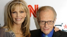 Larry King and his wife Shaun arrive to a party held by CNN celebrating King's fifty years of broadcasting in New York in this April 18, 2007 file photo. (AP / Stuart Ramson)