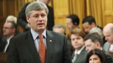 Prime Minister Stephen Harper stands in the House of Commons during Question Period, on Parliament Hill in Ottawa, Wednesday, April 14, 2010. (Fred Chartrand  / THE CANADIAN PRESS)