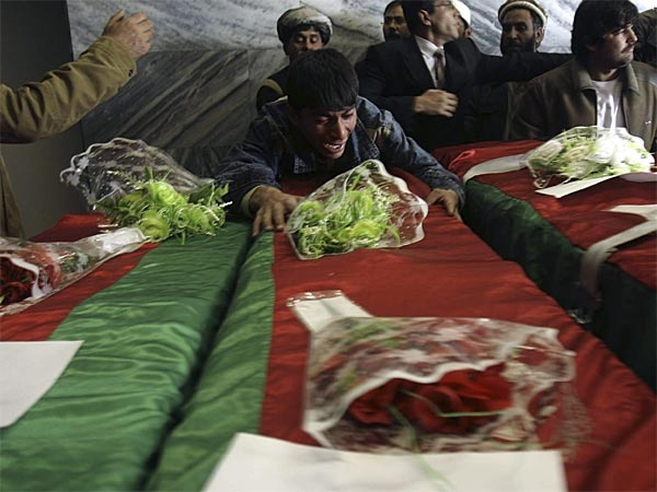 An Afghan boy wails on the coffin of an Afghan lawmaker at a military hospital in Kabul, Afghanistan, Wednesday, Nov 7, 2007. (AP / Rafiq Maqbool)
