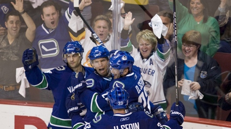 Vancouver Canucks' Mikael Samuelsson, centre, celebrates his second period goal against the Los Angeles Kings with teammates Pavol Demitra, left, Henrik Sedin and Daniel Sedin during NHL western conference playoff hockey action at GM Place in Vancouver, Thursday, April 15, 2010. THE CANADIAN PRESS/Jonathan Hayward