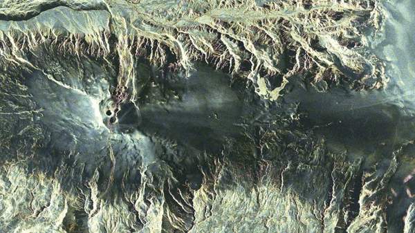 This enhanced satellite image provided by the German Aerospace Centre, DLR, on Friday, April 16, 2010 shows a photo of the volcano under the Eyjafjallajokull glacier on Iceland taken by the TerraSAR-X satellite. (DLR / TerraSAR-X)