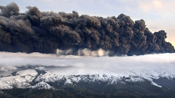 Smoke and steam hangs over the volcano under the Eyjafjallajokull glacier in Iceland, Wednesday April 14, 2010. (AP / Jon Gustafsson)