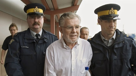 Ernest Fenwick MacIntosh is escorted in custody by RCMP officers at Robert L. Stanfield International Airport in Halifax on Thursday, June 7, 2007. (CP PHOTO/Andrew Vaughan)