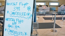A board announces cancelled flights at St. John's International Airport as many major airlines took preventative measures last night because of a giant volcanic ash cloud from Iceland as winds are blowing towards N.L.. on Monday, April 19, 2010.  (Andrew Vaughan / THE CANADIAN PRESS)