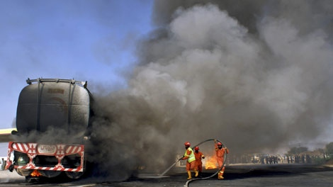 Pakistani firefighters try to extinguish a burning oil tanker after bomb explosions in Takhta Beg, an area of Pakistani Khyber tribal region along Afghan border, Monday, April 19, 2010. (AP Photo/Qazi Rauf)