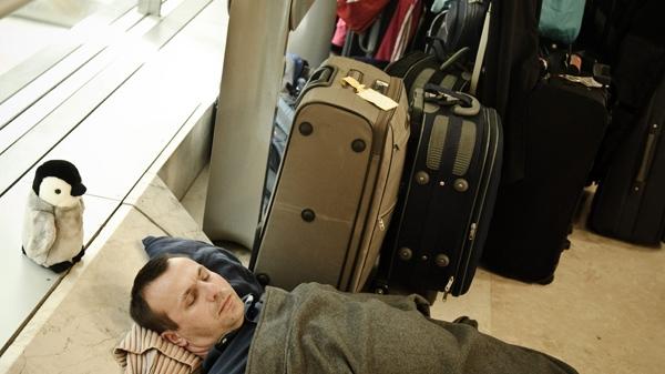 A passenger sleeps at the T4 Barajas airport, in Madrid, Spain, Tuesday, April 20, 2010. (AP / Daniel Ochoa de Olza)