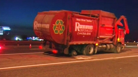 This privately-run garbage truck caused a multi-vehicle crash after its wheels popped off on Highway 403.