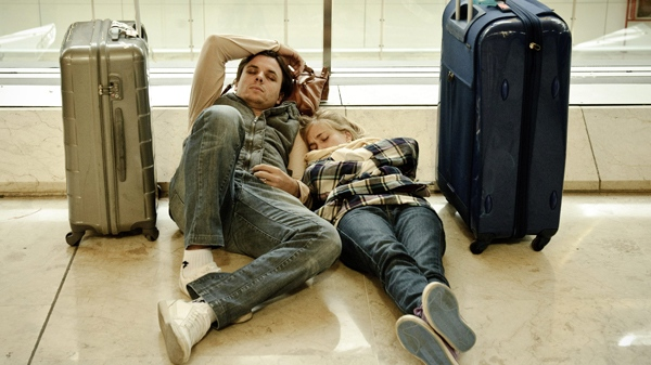 Passengers sleep at the T4 Barajas airport, in Madrid, Spain, Tuesday, April 20, 2010. (AP / Daniel Ochoa de Olza)