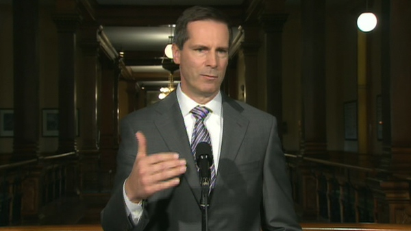 Ontario Premier Dalton McGuinty speaks to reporters from Queen's Park in Toronto, Wednesday, April 21, 2010.