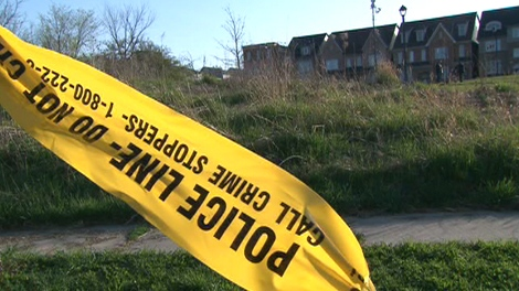 Police tape blocks off the scene of what is described as a 'severe sexual assault' near Murray Ross Parkway on Wednesday, April 21, 2010.