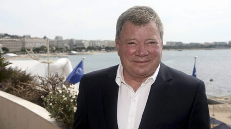 """Canadian actor William Shatner poses for photographers during the MIPTV, International Television Programme Market, Monday, April 12, 2010, in Cannes, southern France. Science fiction legend Shatner announces at MIPTV the launch of """"Weird or What?"""", the new Cinefilix science program. (AP Photo/Lionel Cironneau)"""