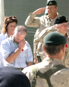Gaetan Dallaire (left) is overcome with emotion remembering his son Kevin at a memorial service at Kandahar Air Field in Afghanistan. Dallaire was killed in an RPG attack last year. (CP / Bill Graveland)