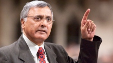 Liberal MP Ujjal Dosanjh gestures as he stands in the House of Commons during Question Period on Parliament Hill in Ottawa on Tuesday, April 20, 2010. (Pawel Dwulit / THE CANADIAN PRESS)