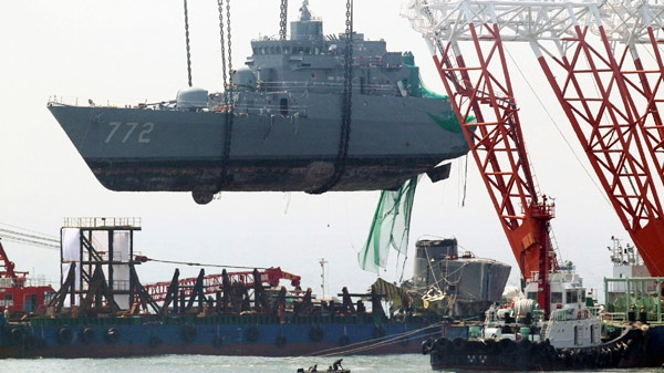 A giant offshore crane salvages a portion of the sunken South Korean naval ship Cheonan off Baengnyeong Island, South Korea, Saturday, April 24, 2010. (AP / Yonhap, Jin Sung-chul)