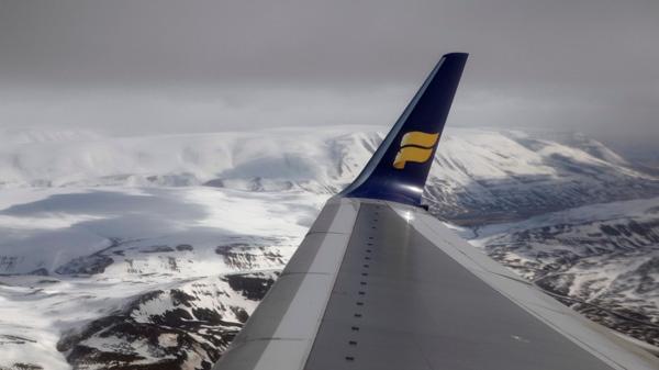 The wing of an Icelandair flight is seen as it leaves Akureyi Airport in Akureyi, Iceland on Saturday, April 24, 2010. (AP / Carolyn Kaster)