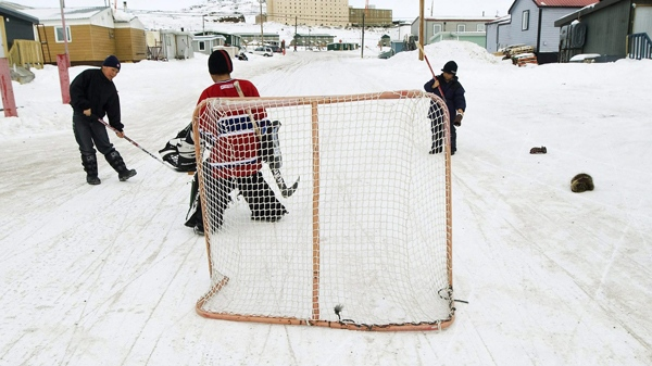 Kids play a game of street hockey in Iqaluit, Nunavut on April 1, 2009. (Nathan Denette / THE CANADIAN PRESS)
