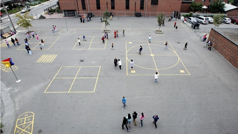 Children play during a 15-minute break at St. Theresa Catholic School in Toronto on Tuesday, Sept. 12, 2006. (CP PHOTO/ Nathan Denette)