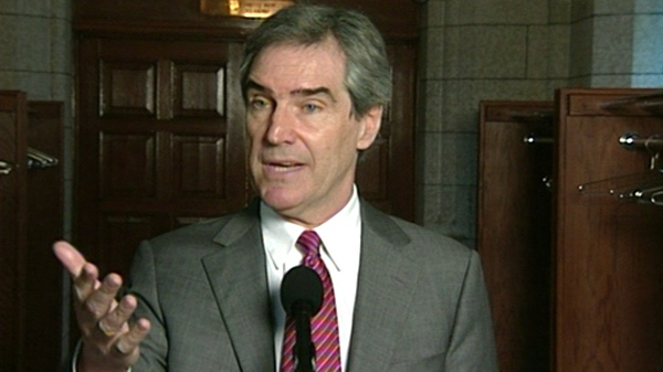 Liberal Leader Michael Ignatieff gestures while speaking to reporters from the halls on Parliament Hill, Wednesday, April 28, 2010.