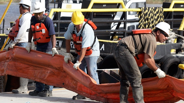 Workers load oil booms onto a boat to assist in the containment of oil from a leaking pipeline in the Gulf of Mexico near the coast of Louisiana in Venice, La., Thursday, April 29, 2010. (AP / Patrick Semansky)