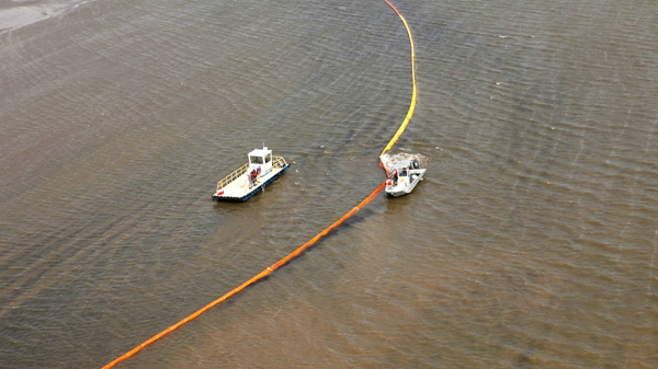 Workers ready oil booms in preparation of the looming oil spill from last week's collapse and spill of the Deepwater Horizon oil rig in Port Eads, La., Thursday, April 29, 2010. (AP / Gerald Herbert)
