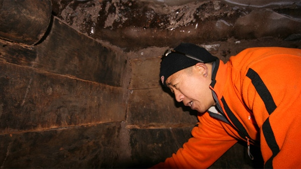 A member of the research team search inside what they claim is the remains of Noah's Ark near the peak of Mount Ararat in Turkey.