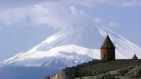 In this April 18, 2001 file photo, a church in Armenia's Ararat region is seen in front of Mount Ararat, as viewed from Armenia. (AP Photo/Misha Japaridze, file)