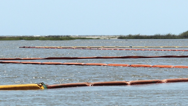 Oil containment booms guard the rear of Coast Guard Island near the Louisiana coast Thursday, April 29, 2010. (AP / Bill Haber)