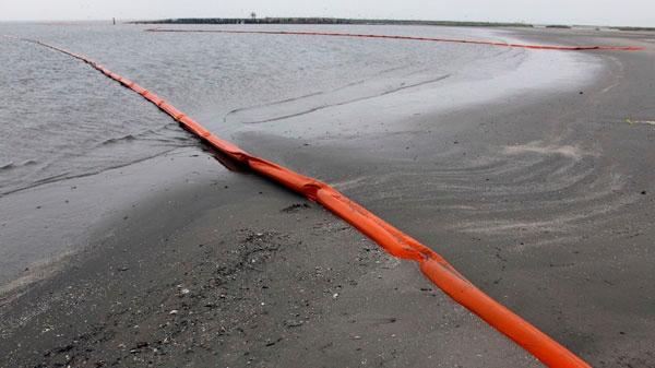 Two containment booms are seen Friday, April 30, 2010 on Breton Island, La. (AP / Alex Brandon)
