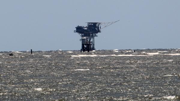 A production platform is shown just off the Louisiana coast near South Pass, Thursday, April 29, 2010. (AP / Bill Haber)