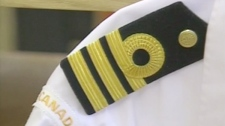 The executive curl, a loop of braid that appears above an officer's rank insignia on their epaulettes and tunic sleeves, has been reinstated to mark the navy's 100th anniversary in Canada.