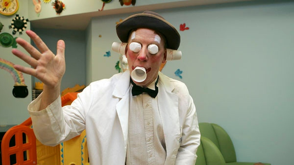 Clown doctor Stephen Ringold performs for Christopher Sava, 4, right, during Ringold's Clown round at New York-Presbyterian's Morgan Stanley Children's Hospital in New York on Friday, Dec. 1, 2006. (AP / Dima Gavrysh)