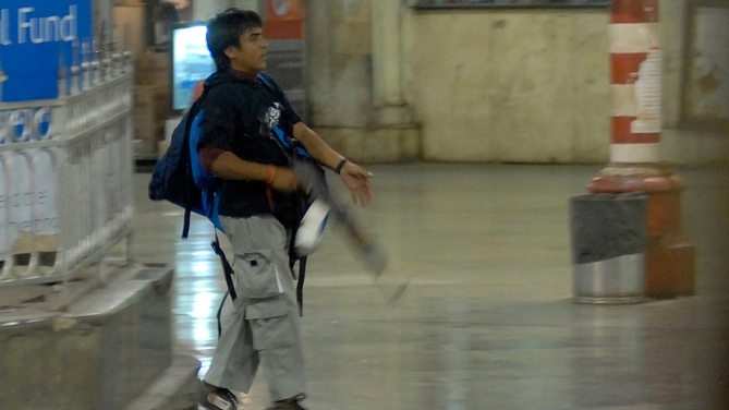 An armed Mohammed Ajmal Kasab walks at the Chatrapathi Sivaji Terminal railway station in Mumbai, India on Wednesday, Nov. 26, 2008. (AP / Mumbai Mirror, Sebastian D'souza)