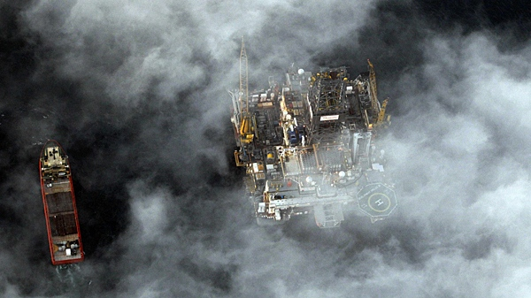 A rig drilling a relief well and support vessels are located at the site of the recent collapse and spill of the Deepwater Horizon oil rig in the Gulf of Mexico, La., Tuesday, May 4, 2010. (AP / Eric Gay)