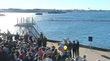 Family and friends watch from the docks as HMCS Fredericton pulls into port in Halifax, N.S. on Tuesday, May 4, 2010.